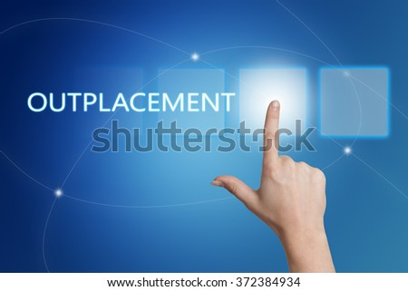 Outplacement - hand pressing button on interface with blue background. - stock photo