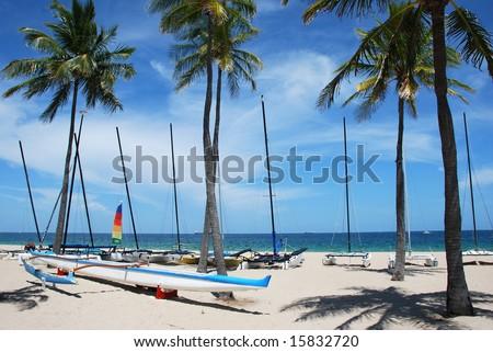 Outrigger Canoe on Beach - stock photo