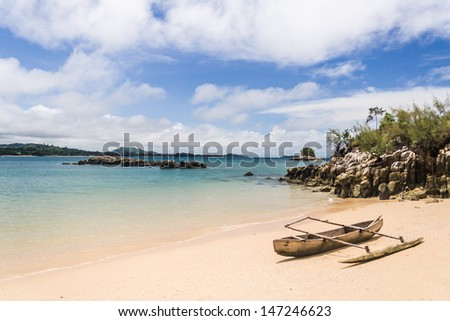 Outrigger canoe on the beach of Nosy Be, Madagascar