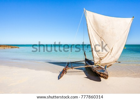 Outrigger canoe, traditional Vezo fishing boat beached in the lagoon of south-western Madagascar