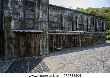 Outside disused warehouse - stock photo