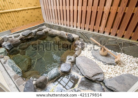 Outside Japanese hot bath made with stones - stock photo