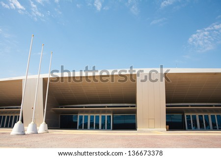Outside Khalifa sports stadium in Doha, Qatar, Middle East, where the 2006 Asian games were hosted and location for the proposed 2016 Olympic Games (wide angle lens distortion on edges) - stock photo