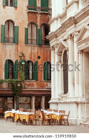 Outside restaurant tables on the Venetian piazza - stock photo
