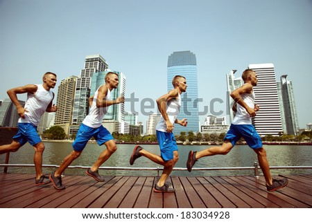 Outside running sportsman marathon in the city - stock photo