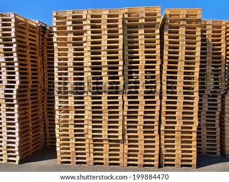 Outside stock of new manufactured  wooden euro pallets - stock photo