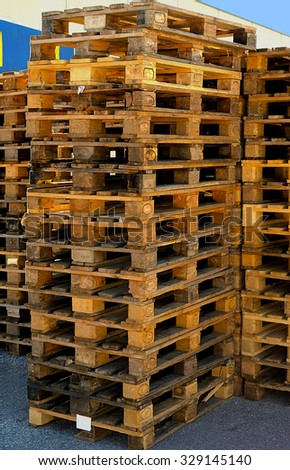 Outside stock of old manufactured wooden euro pallets - stock photo