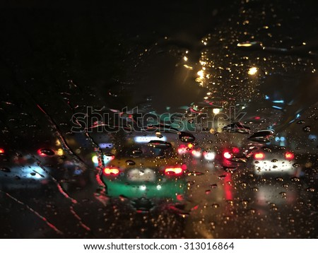 Outside the car in the rain night day - stock photo