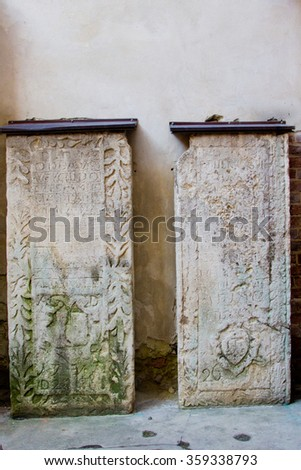 Outside the historical building of The Armenian Cathedral of the Assumption of Mary. Old stone slabs