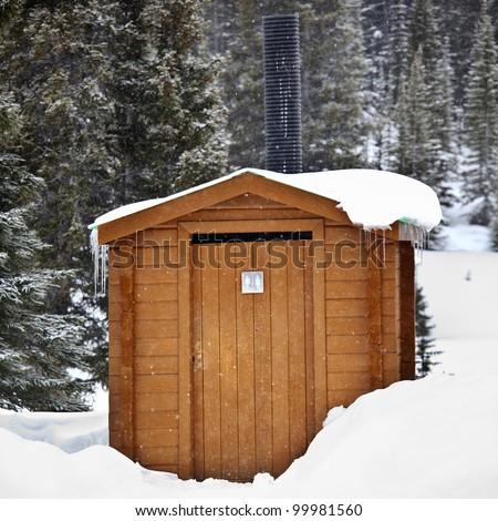 Outside toilet covered in snow in Jasper National Park, Alberta, Canada. - stock photo