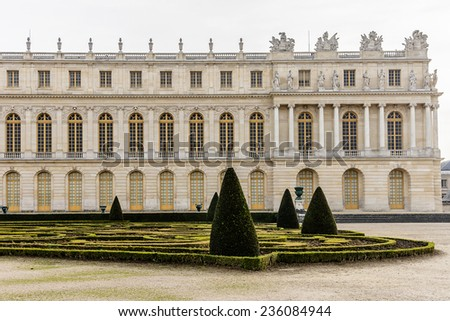 Outside view from the garden of famous Palace Versailles. The Palace Versailles was a royal chateau. It was added to the UNESCO list of World Heritage Sites. Paris, France. - stock photo