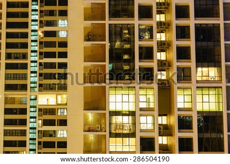 Outside view of apartments of a high class building at night in Hanoi Vietnam - stock photo