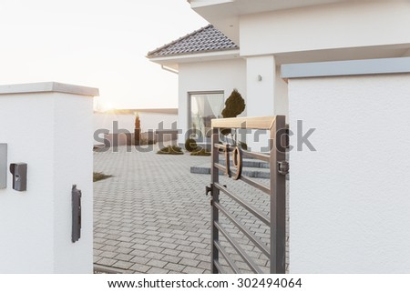 Outside view of the mansion area with steal gateway - stock photo