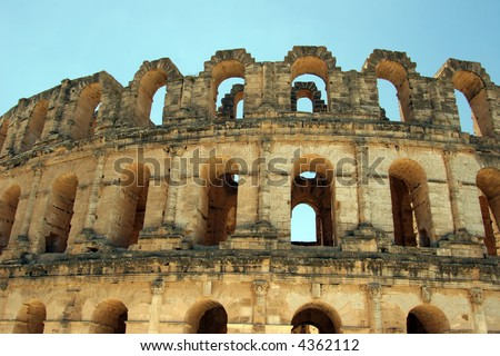Outside view of the Roman coliseum of Thysdrus at El Jem, Tunisia - stock photo