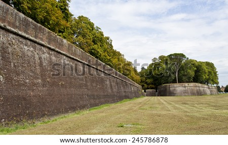 Outside view of the solid ancient fortress walls of Lucca, an Italian town in Tuscany. - stock photo
