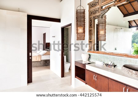 Outside washing area with the toilet and bedroom attached closely and exposed to the outside in a modern house - stock photo