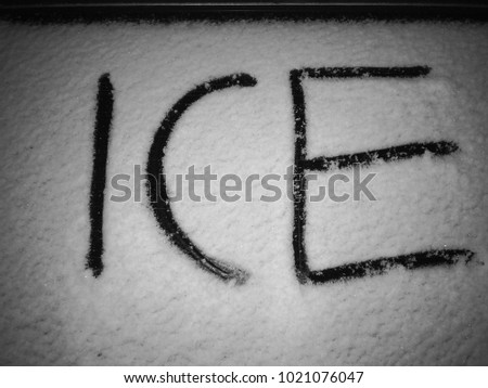 Outside word ice written in snow