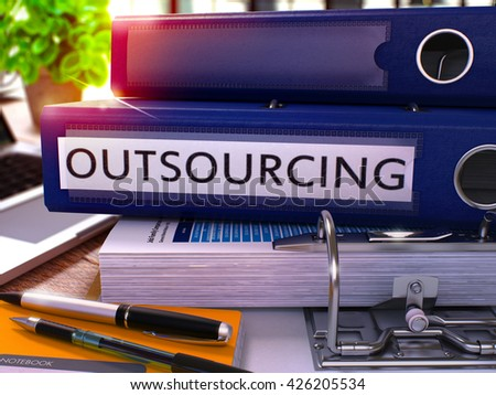 Outsourcing - Blue Ring Binder on Office Desktop with Office Supplies and Modern Laptop. Outsourcing Business Concept on Blurred Background. Outsourcing - Toned Illustration. 3D Render. - stock photo