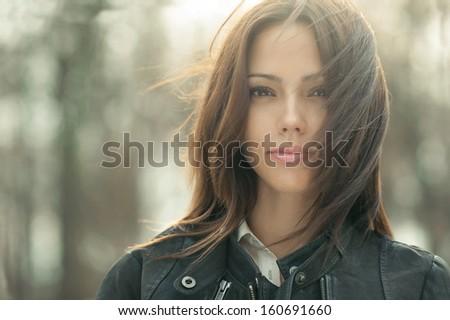 Outstanding young beautiful woman face - closeup - stock photo