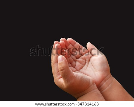 Outstretched cupped hands of young girl - isolated on black background