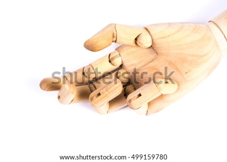 Outstretched wooden hand, isolated over white background