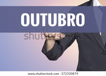 Outubro (October In portuguese) word Business man touch on virtual screen soft sweet vintage background - stock photo