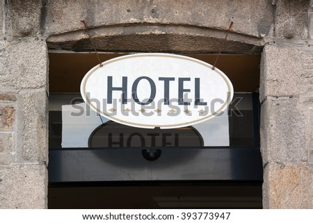 Oval Hotel Sign above the entrance of a Accommodation in Brittany, France