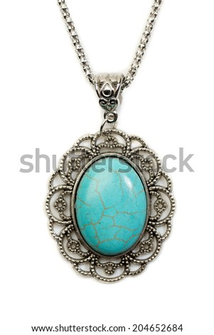 Oval pendant with turquoise stone in a silver frame. Isolate on white. - stock photo