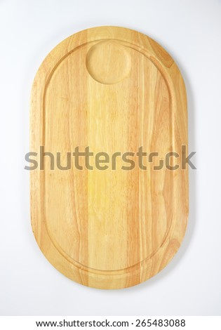 Oval wooden cutting board on white background