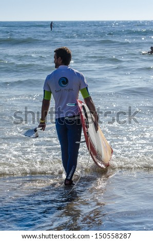 OVAR, PORTUGAL - AUGUST 18: Alexandre Tavares at 4st stage of National Stand up paddle Championship  on august 18, 2013 in Ovar, Portugal.