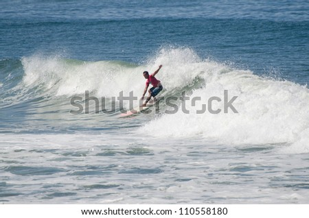 OVAR, PORTUGAL - AUGUST 19: Bruno Charneca at 1st stage of National Longboard Championship  on august 19, 2012 in Ovar, Portugal.