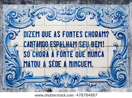 OVAR, PORTUGAL - SEPTEMBER 3, 2016: Panel of traditional Portuguese tiles hand-painted blue and white, with written quoted verses from a poem about water.
