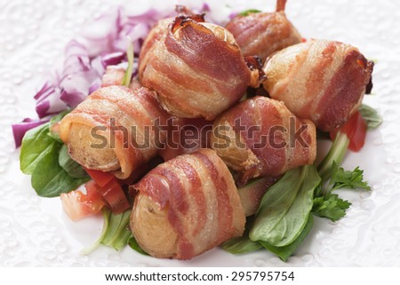 Oven baked baby potato wrapped in pancetta bacon - stock photo