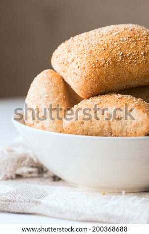 Oven baked bread in bowl. Selective focus. Shallow DOF - stock photo