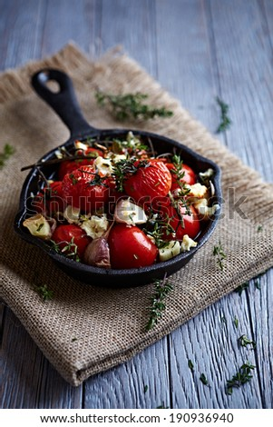 Oven-Baked Cherry Tomatoes with Garlic and Feta  - stock photo