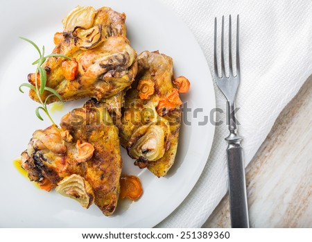 Oven-baked chicken wings with vegetables - stock photo