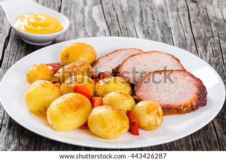 Potato dish stock images royalty free images vectors shutterstock oven baked new potatoes with sea salt red bell pepper and pork tenderloin cutting into ccuart Image collections
