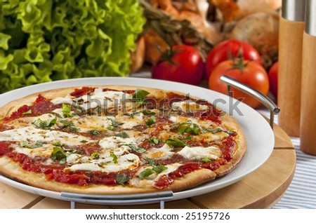 Oven baked pizza served on wooden board - stock photo