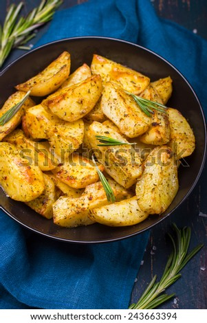 Oven Baked potatoes with herbs, top view - stock photo