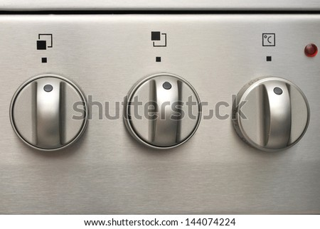 Oven control Knobs - close up - stock photo