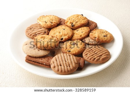 Oven Fresh Cookies And Biscuits Served In Plate.