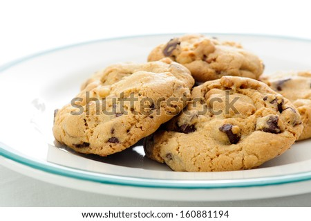 oven fresh home made chocolate chip and walnut cookies - stock photo