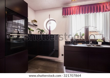 Oven in the black kitchen in the diamond house  - stock photo