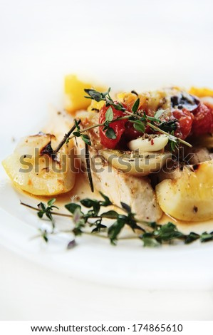 oven-roasted rosemary chicken with tomatoes - stock photo