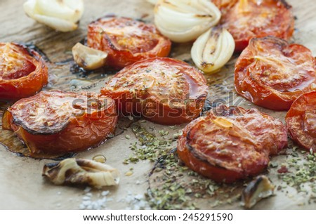 Oven roasted tomato, onion and garlic spiced with oregano and sea salt. - stock photo
