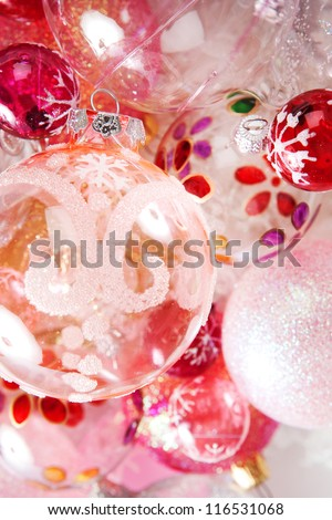 Over head close up view of a bunch of different size and design christmas balls in various colors. - stock photo