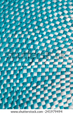 Over head detail close up view of a circle woven fabric textile texture in blue and white colors. Arts and crafts backdrop background. Full frame texture pattern background. - stock photo