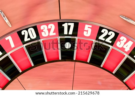 Over head sot of an American roulette wheel winning number seventeen - stock photo
