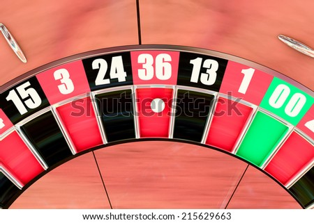 Over head sot of an American roulette wheel winning number thirty six
