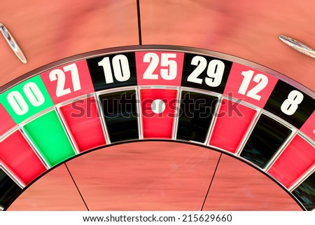 Over head sot of an American roulette wheel winning number twenty five - stock photo
